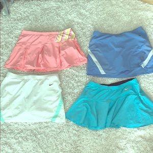 4 SZ. Medium NIKE DRY FIT GOLF/tennis skirts